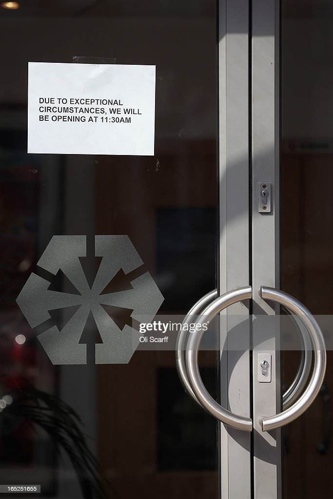 A notice on the door of a branch of Laiki Bank UK, a subsiduary of Cyprus Popular Bank, informs customers of a delayed opening time on April 2, 2013 in London, England. Customers with funds in Laiki Bank UK will not face a levy on their accounts, which is being imposed in Cyprus on deposits of over 100,000 Euros as part of the European Union's bail-out package for the Cypriot economy. The Bank of England's Prudential Regulation Authority has announced that all deposits in Laiki Bank UK will be automatically transferred to Bank of Cyprus in the UK.
