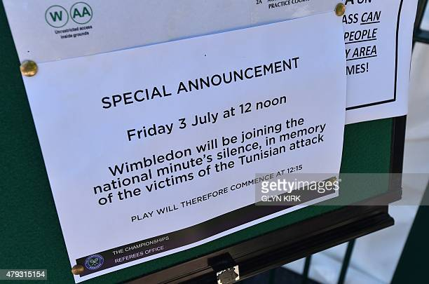 A notice posted at the exit of the practice courts alerts players and visitors to the minute's silence in memory of those murdered in the June 26...