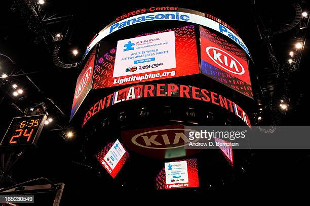 A notice that 'April is World Autism Awareness Month' is displayed on the jumbotron at Staples Center during a game between the Indiana Pacers and...