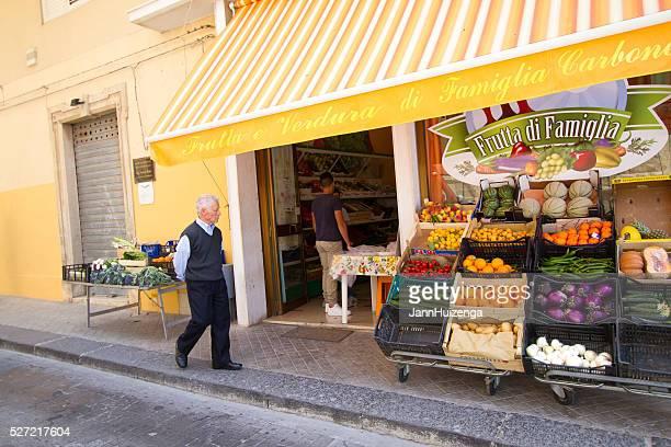 Noto, Sicily: Senior Man Walks By Fruit and Veggie Shop
