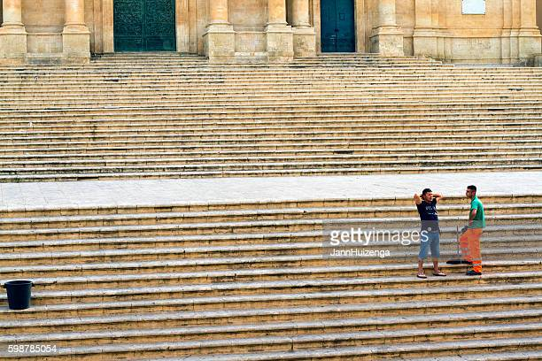 Noto, Sicily: Street Sweeper Chats with Friend on Cathedral Steps