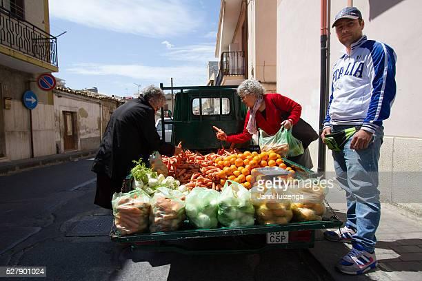 Noto, Sicily: Veggie Vendor, Truck, Shoppers Inspecting Carrots