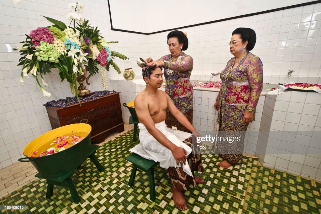 Notonegoro (C), in Bangsal Kesatriyan at Kraton Palace during Bathe Ritual, know as 'Siraman' Ritual as part of the Royal Wedding Held For Sultan Hamengkubuwono X's Daughter Gusti Ratu Kanjeng Hayu And KPH Notonegoro on October 21, 2013 in Yogyakarta, Indonesia. Wedding celebrations will take place October 21-23 October. The wedding parade will include 12 royal horse drawn carriages and will be streamed live on the internet so that it can be watched by people all over the world.