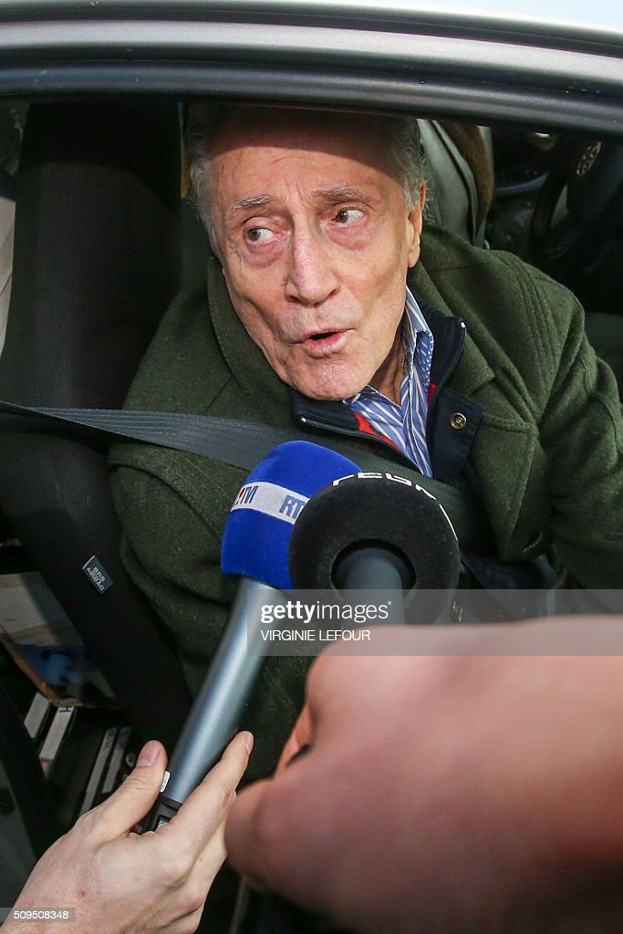 Notorious Belgian criminal Marcel Habran answers journalists' questions as he leaves by car the Nivelles prison, on February 11, 2016. Habran, 82, who was sentenced to a 15-year-imprisonment in 2010, is released with an ankle bracelet. / AFP / Belga / VIRGINIE LEFOUR / Belgium OUT