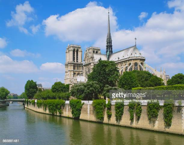 Notre Dame cathedral over urban canal, Paris, Ile-de-France, France