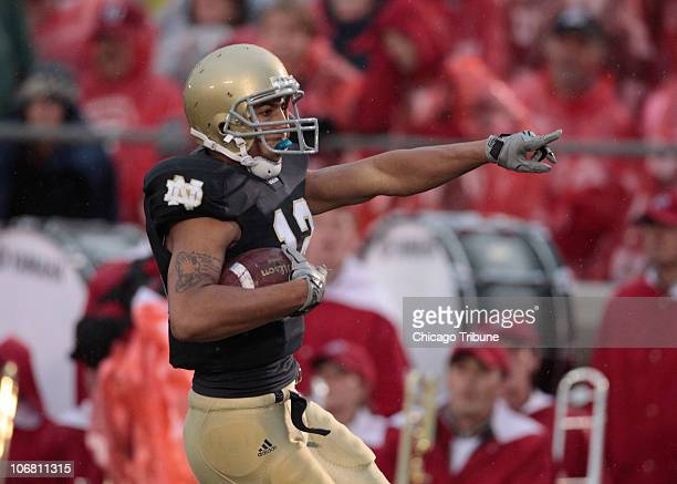Notre Dame cornerback Robert Blanton celebrates his touchdown on a blocked punt against Utah during the first quarter at Notre Dame Stadium in South...