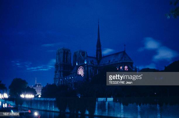 Notre Dame De Paris Is 800 Years Old A Paris la cathédrale NOTREDAME de nuit éclairée de l'intérieur à travers ses vitraux