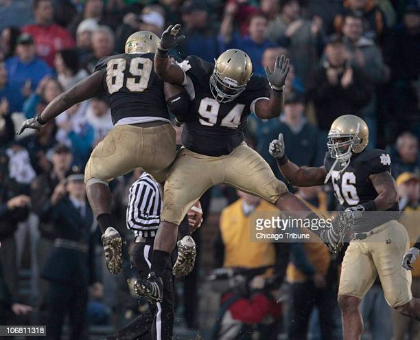 Notre Dame defensive end Kapron LewisMoore and teammate Hafis Williams celebrate late in the fourth quarter after stopping a drive by Utah at Notre...