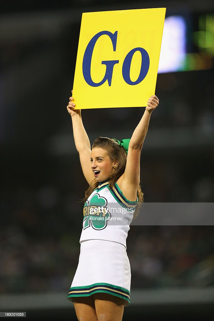 A Notre Dame Fighting Irish cheerleader at Cowboys Stadium on October 5, 2013 in Arlington, Texas.