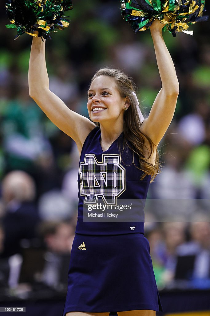 Notre Dame Fighting Irish cheerleader seen on the court during a break in action against the Connecticut Huskies at Purcel Pavilion on March 4, 2013 in South Bend, Indiana. Notre Dame defeated Connecticut 96-87 in triple overtime to win the Big East regular season title.