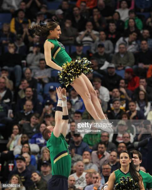 Notre Dame Fighting Irish cheerleaders cheer during the NCAA Division I Men's Basketball Championship first round game between Princeton Tigers and...