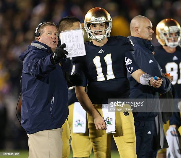 Notre Dame Fighting Irish coach Brian Kelly speaks with Notre Dame quarterback Tommy Rees after a last first down against the Michigan Wolverines at...