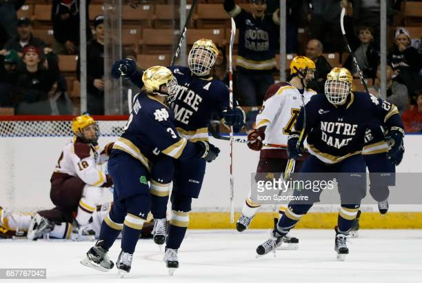 Notre Dame Fighting Irish defenseman Jordan Gross celebrates with goal scorer Notre Dame Fighting Irish right wing Anders Bjork during an NCAA...