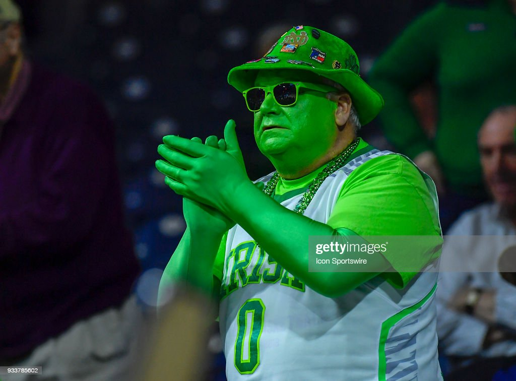 A Notre Dame Fighting Irish fan cheers during the game between the Notre Dame Fighting Irish and the Villanova Wildcats during the second round of the Division I Women's Championship on March 18, 2018 in South Bend, Indiana.