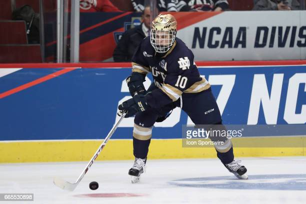 Notre Dame Fighting Irish forward Anders Bjork controls a loose puck during the second period of the NCAA Frozen Four semifinal game between the...