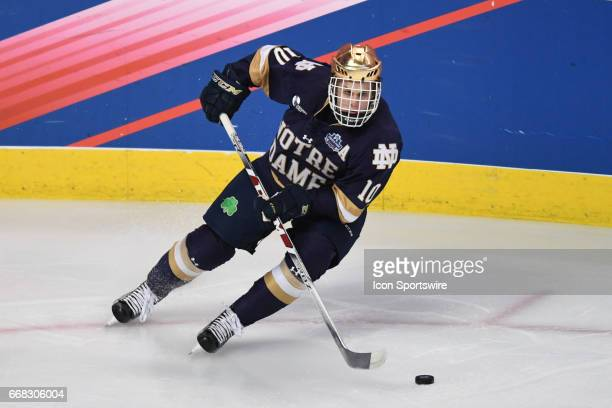 Notre Dame Fighting Irish forward Anders Bjork controls the puck in the first period of an NCAA Frozen Four semifinal game with the Denver Pioneers...