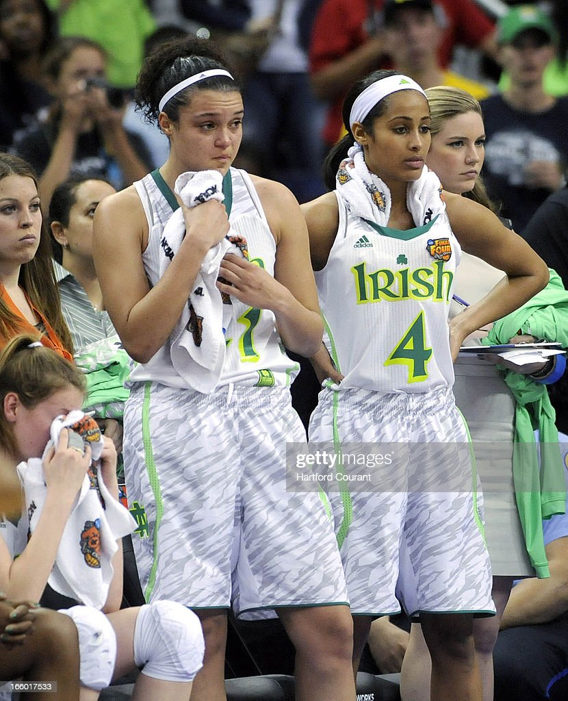 Notre Dame Fighting Irish forward Natalie Achonwa (11) and Notre Dame Fighting Irish guard Skylar Diggins (4) watch as the clock runs down in the final minute of the women's NCAA semifinal in New Orleans, Louisiana. UConn won, 83-65.