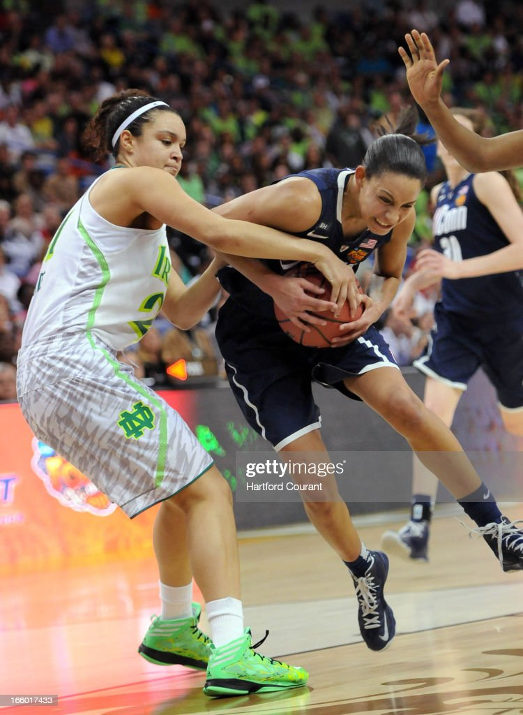 Notre Dame Fighting Irish forward Natalie Achonwa (11) fouls Connecticut Huskies guard Bria Hartley (14) on a drive to the hoop during the women's NCAA semifinal in New Orleans, Louisiana. UConn won, 83-65.