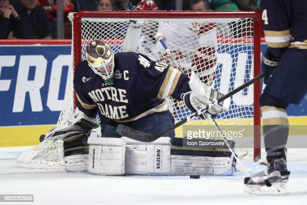 Notre Dame Fighting Irish goalie Cal Petersen blocks a shot with his pads during the second period of the NCAA Frozen Four semifinal game between the...