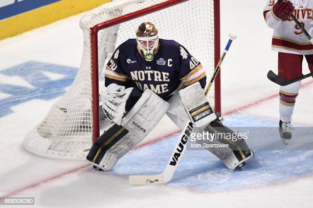 Notre Dame Fighting Irish goalie Cal Petersen defends the net in the first period of an NCAA Frozen Four semifinal game with the Denver Pioneers and...