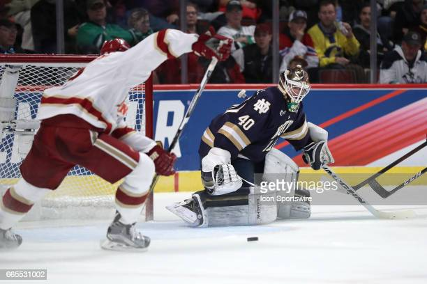 Notre Dame Fighting Irish goalie Cal Petersen is unable to block a shot from Denver Pioneers defenseman Tariq Hammond for a goal during the second...