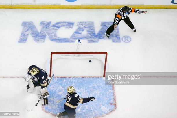 Notre Dame Fighting Irish goaltender Cal Petersen and Notre Dame Fighting Irish defenseman Bobby Nardella react as the referee calls good goal during...