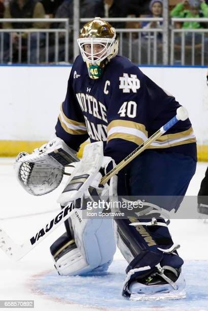 Notre Dame Fighting Irish goaltender Cal Petersen eyes the puck in the corner during the NCAA Northeast Regional final between the UMass Lowell River...