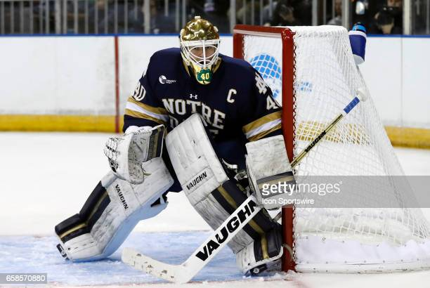 Notre Dame Fighting Irish goaltender Cal Petersen holds the short side during the NCAA Northeast Regional final between the UMass Lowell River Hawks...