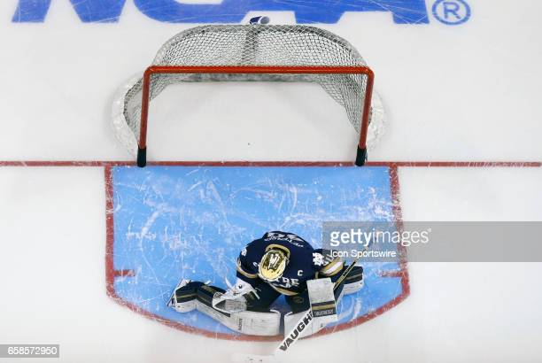 Notre Dame Fighting Irish goaltender Cal Petersen makes a glove save in warm up before the NCAA Northeast Regional final between the UMass Lowell...