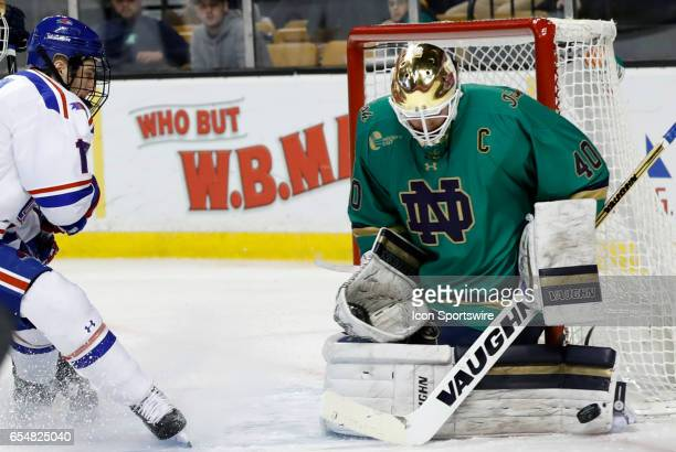 Notre Dame Fighting Irish goaltender Cal Petersen makes a left pad save during a Hockey East semifinal between the UMass Lowell River Hawks and the...