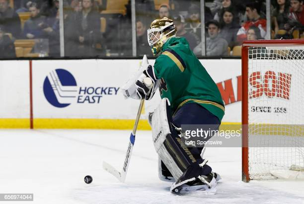 Notre Dame Fighting Irish goaltender Cal Petersen makes a stick save during a Hockey East semifinal between the UMass Lowell River Hawks and the...