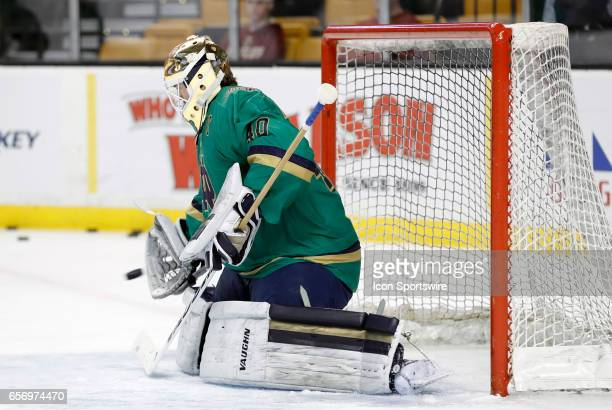 Notre Dame Fighting Irish goaltender Cal Petersen stops a shot in warm up before a Hockey East semifinal between the UMass Lowell River Hawks and the...