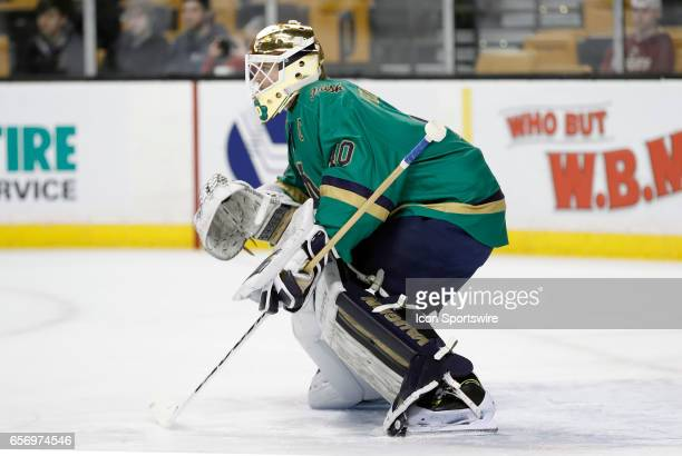 Notre Dame Fighting Irish goaltender Cal Petersen warms up before a Hockey East semifinal between the UMass Lowell River Hawks and the Notre Dame...