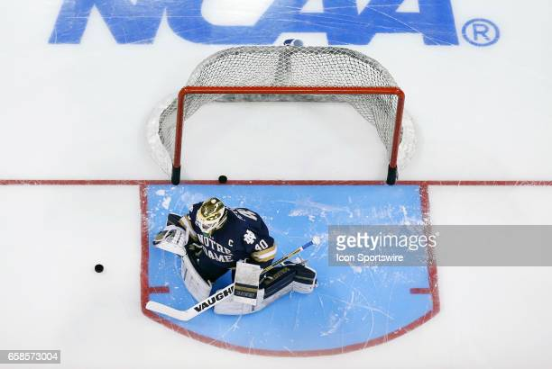Notre Dame Fighting Irish goaltender Cal Petersen warms up before the NCAA Northeast Regional final between the UMass Lowell River Hawks and the...