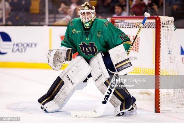 Notre Dame Fighting Irish goaltender Cal Petersen watches a deflected puck during the second period of the Hockey East Conference Championship...
