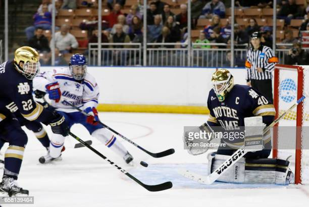 Notre Dame Fighting Irish goaltender Cal Petersen watches a shot during the NCAA Northeast Regional final between the UMass Lowell River Hawks and...