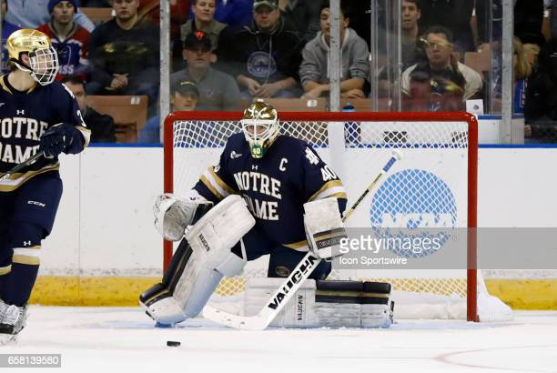 Notre Dame Fighting Irish goaltender Cal Petersen watches the loose rebound during the NCAA Northeast Regional final between the UMass Lowell River...