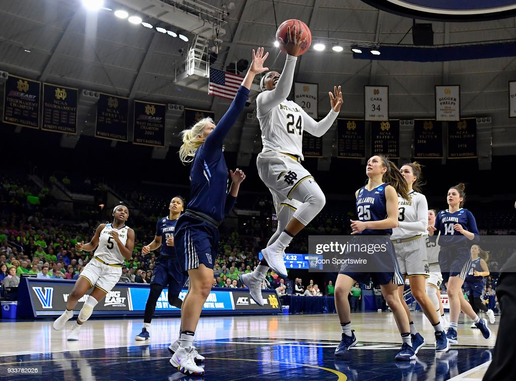 Notre Dame Fighting Irish guard Arike Ogunbowale (24) shoots a layup on Villanova Wildcats guard Alex Louin (2) during the second round of the Division I Women's Championship on March 18, 2018 in South Bend, Indiana.