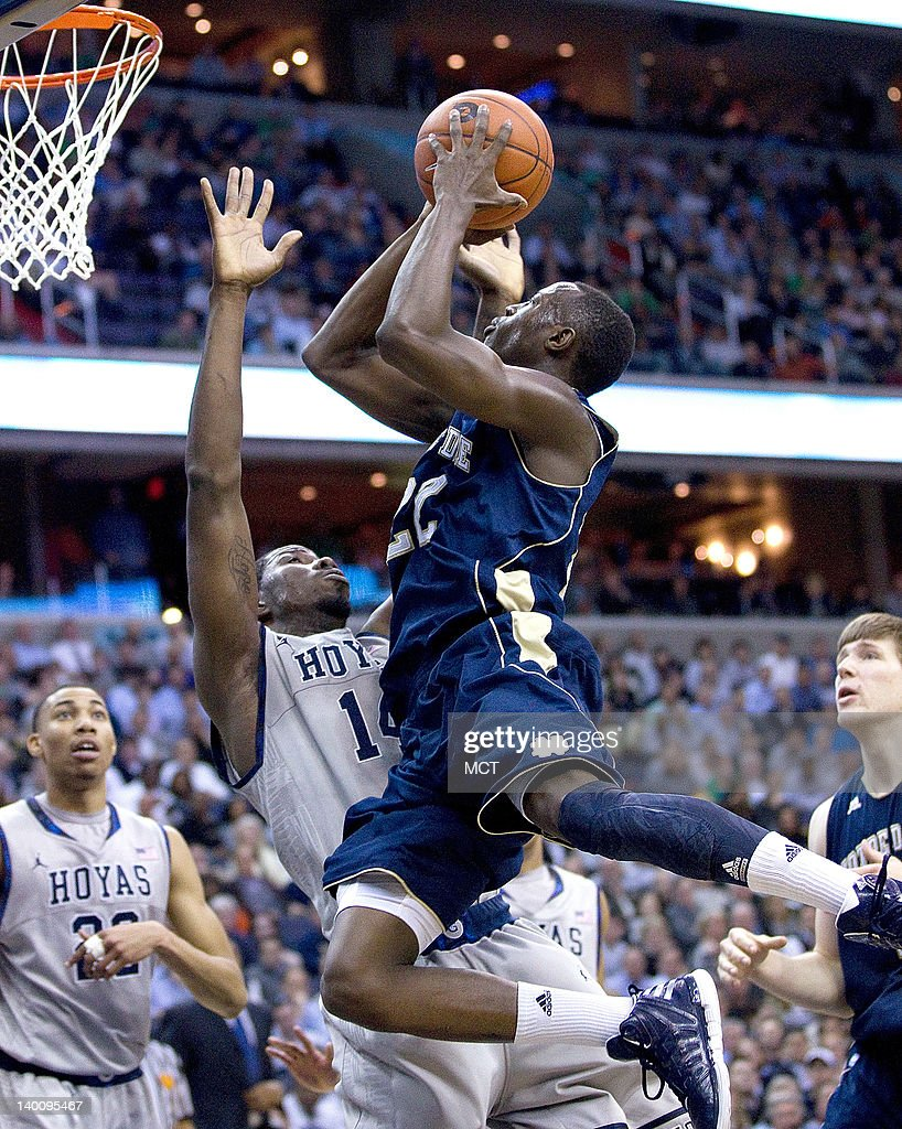 Notre Dame Fighting Irish guard Jerian Grant (22) shoots over Georgetown Hoyas center Henry Sims (14) during the first half of their game played at the Verizon Center in Washington, D.C., Monday, February 27, 2012.