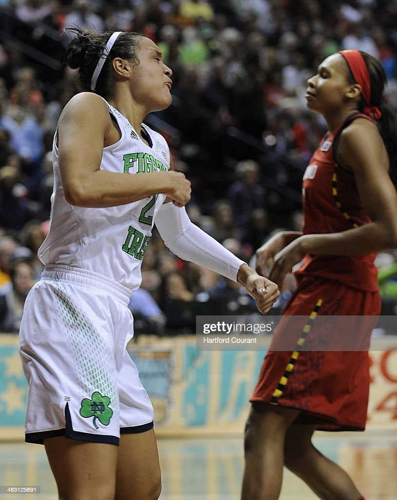 Notre Dame Fighting Irish guard Kayla McBride (21) gets pumped after scoring a bucket and drawing the foul against Maryland Terrapins center Alicia DeVaughn (13) during the first half of the NCAA women's Final Four in Nashville, Tenn., on Sunday, April 6, 2014.