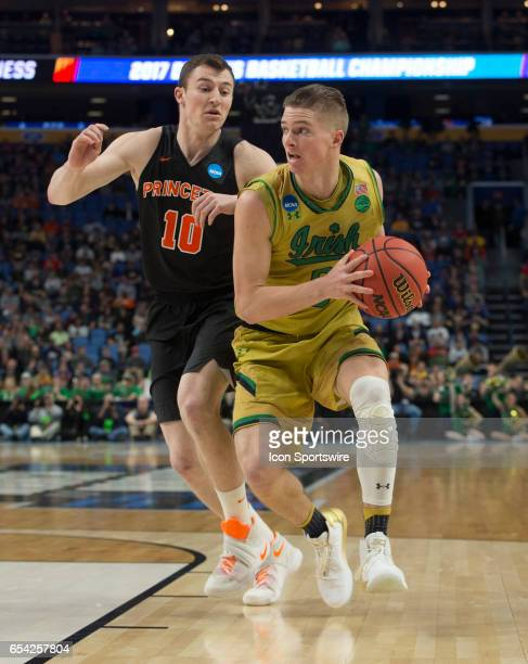 Notre Dame Fighting Irish guard Matt Farrell drives the lane on Princeton Tigers forward Spencer Weisz during the NCAA Division I Men's Basketball...