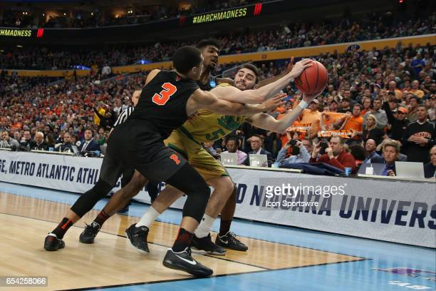 Notre Dame Fighting Irish guard Matt Farrell is fouled by Princeton Tigers guard Devin Cannady during the NCAA Division I Men's Basketball...