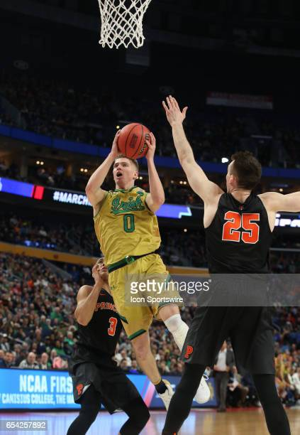 Notre Dame Fighting Irish guard Rex Pflueger splits the Princeton Tigers defense during the NCAA Division I Men's Basketball Championship first round...