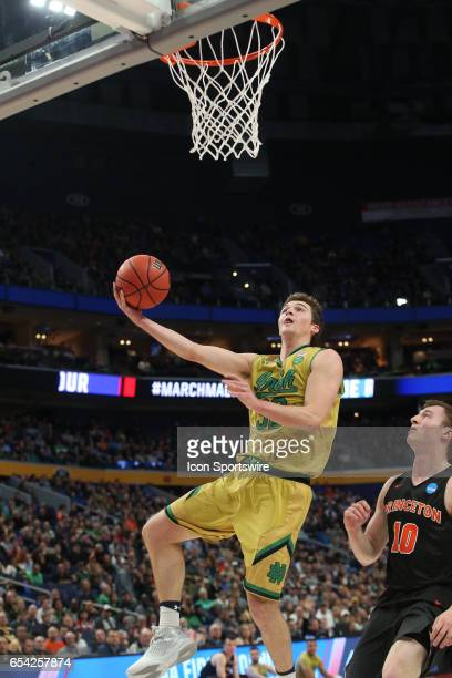 Notre Dame Fighting Irish guard Steve Vasturia scoops the ball up and into the basket during the NCAA Division I Men's Basketball Championship first...