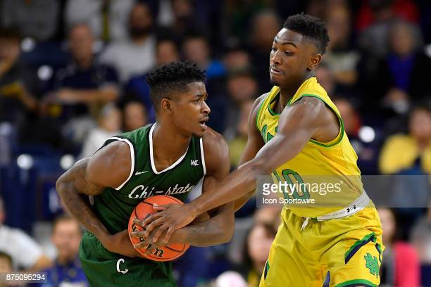 Notre Dame Fighting Irish guard Temple Gibbs defends Chicago State Cougars guard Jelani Pruitt during the game between the Chicago State Cougars and...