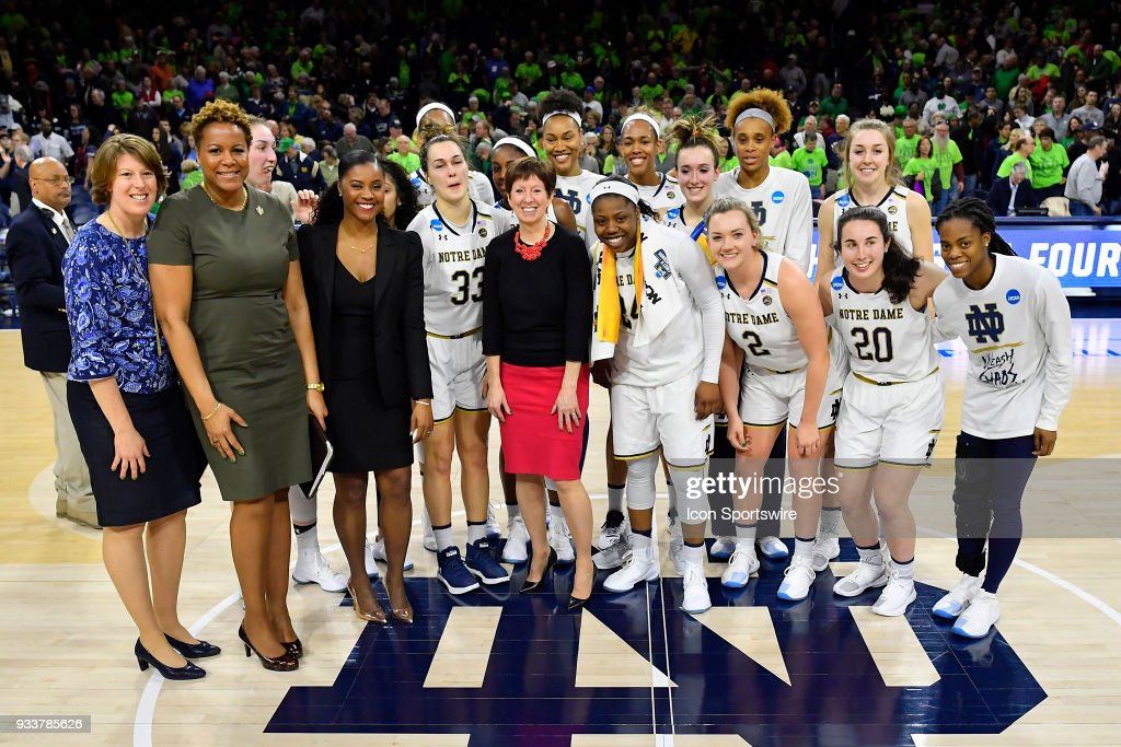 Notre Dame Fighting Irish head coach Muffet McGraw and team poses after defeating the Villanova Wildcats during the second round of the Division I Women's Championship on March 18, 2018 in South Bend, Indiana.