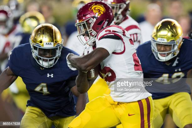 Notre Dame Fighting Irish linebacker Te'von Coney runs in to tackle USC Trojans running back Ronald Jones II during the college football game between...