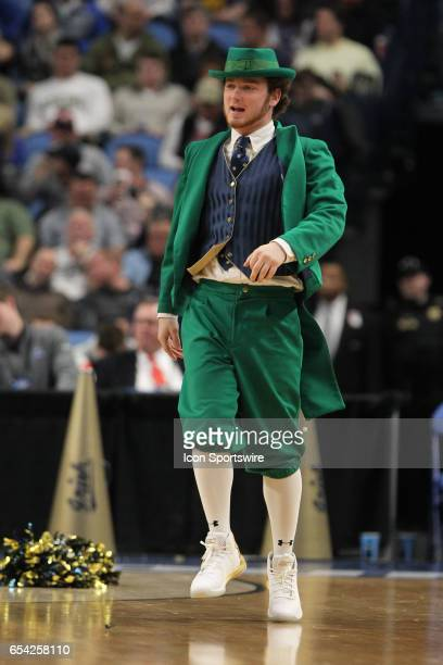 Notre Dame Fighting Irish mascot cheers during the NCAA Division I Men's Basketball Championship first round game between Princeton Tigers and Notre...