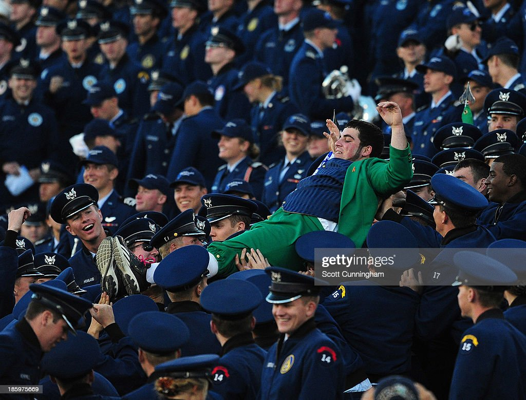 Notre Dame Fighting Irish masot Lucky The Leprechaun crowd surfs through Cadets during the game against the Air Force Falcons at Falcon Stadium on October 26, 2013 in Colorado Springs, Colorado.