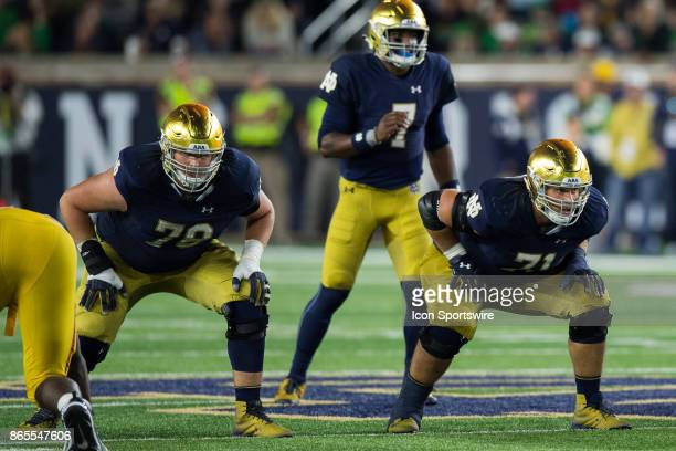 Notre Dame Fighting Irish offensive lineman Tommy Kraemer and Notre Dame Fighting Irish offensive lineman Alex Bars wait for the snap during the...